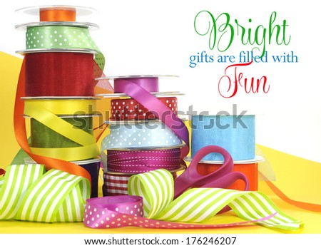 Bright multi color gift wrapping ribbons and scissors with sample text or copy space for Easter, birthday, Christmas or festive occasions.. - stock photo