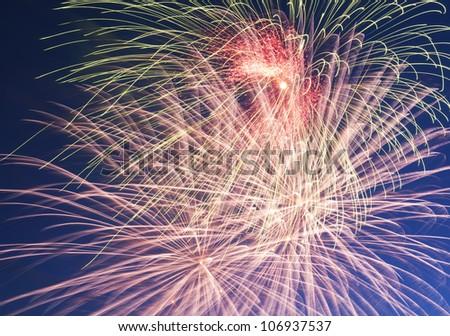 Bright multicolored firework in a dark sky. - stock photo