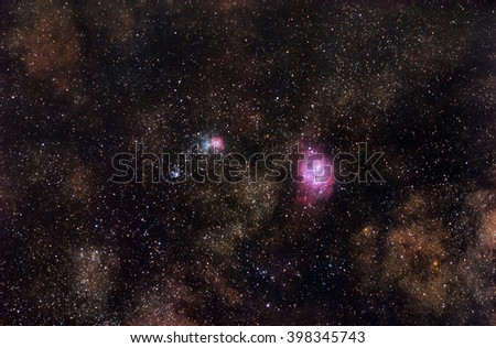 Bright nebulae shining among the stars of Milky Way - stock photo