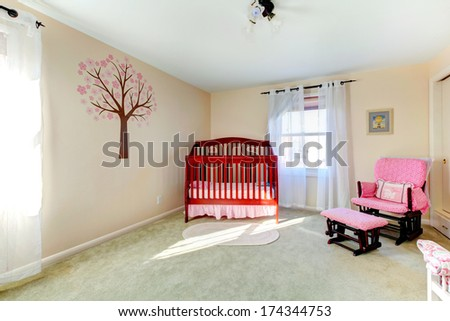 Bright neutral color baby room with ivory decorated wall - stock photo