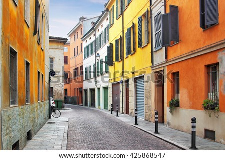 Bright old street with colored architecture in Parma, Emilia-Romagna province, Italy. - stock photo