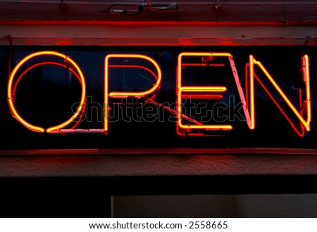 bright orange and red neon bar sign, saying open - stock photo