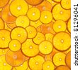bright orange background from slices of juicy oranges - stock photo