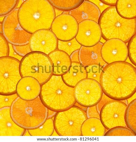 bright orange background from slices of juicy oranges - stock photo