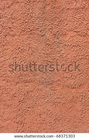 Bright orange textured wall - stock photo