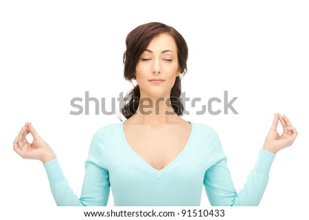 bright picture of beautiful woman in meditation - stock photo
