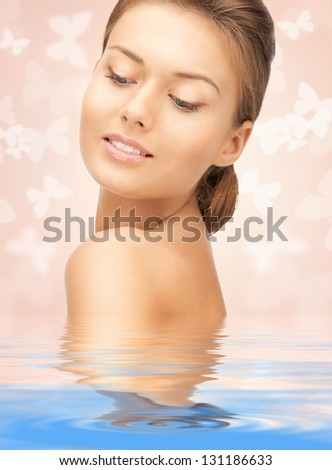 bright picture of beautiful woman with butterflies in water - stock photo
