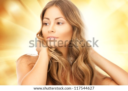 bright picture of beautiful woman with long hair - stock photo