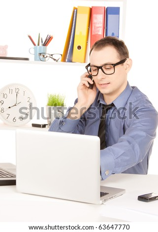 bright picture of businessman with laptop computer in office - stock photo