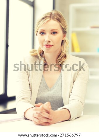 bright picture of calm and serious woman - stock photo