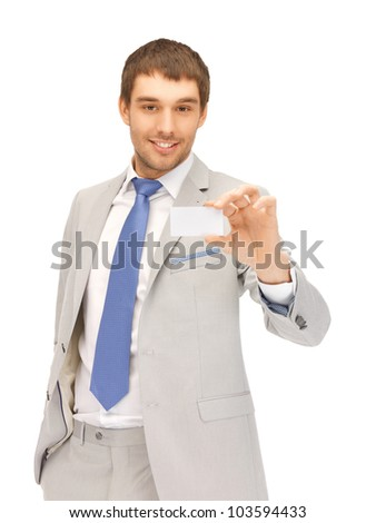 bright picture of confident businessman with business card - stock photo