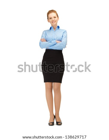 bright picture of friendly young smiling businesswoman .. - stock photo