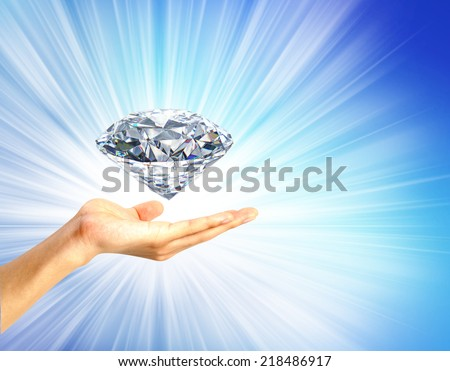 bright picture of  hand with big diamond. Concept most precious beauty. - stock photo