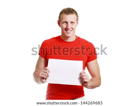 bright picture of handsome man holding blank note card paper - stock photo