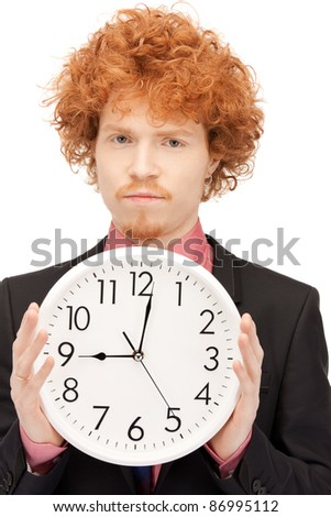 bright picture of handsome man with clock - stock photo