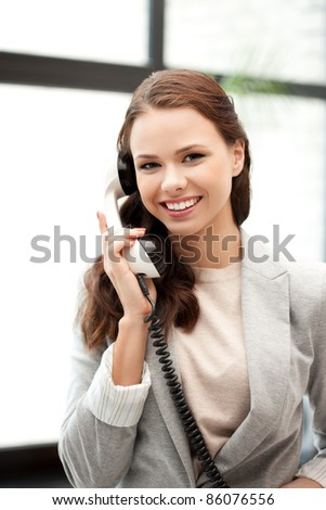 bright picture of happy businesswoman with phone - stock photo