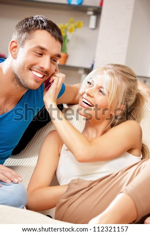 bright picture of happy couple with cellphone - stock photo