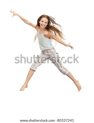 bright picture of happy jumping teenage girl - stock photo