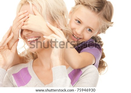bright picture of happy mother and little girl - stock photo