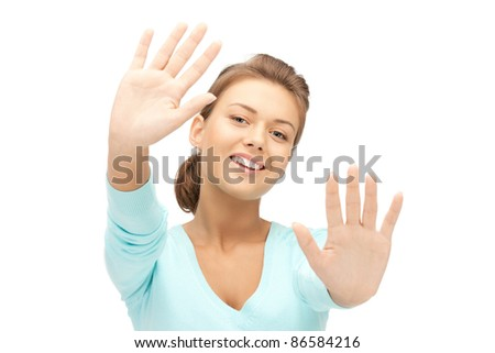 bright picture of happy woman showing her palms - stock photo