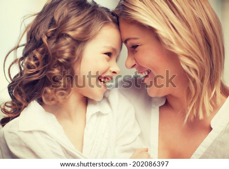 bright picture of hugging mother and daughter - stock photo