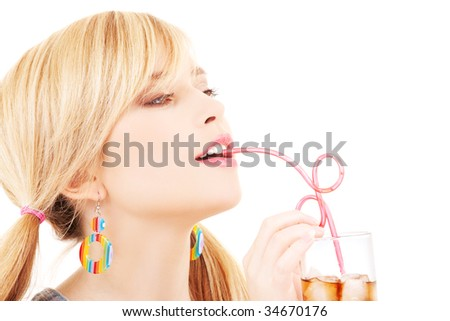 bright picture of lovely girl with glass of drink - stock photo