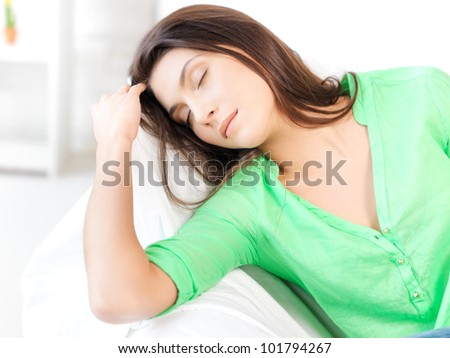 bright picture of lovely sleeping woman at home - stock photo