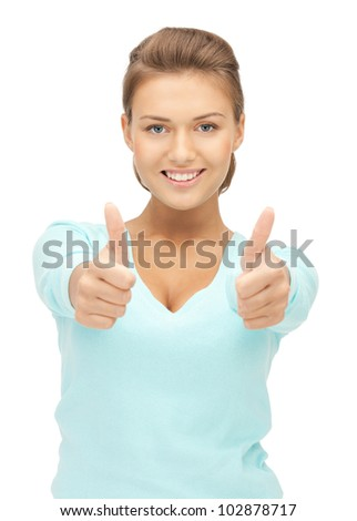 bright picture of lovely teenage girl with thumbs up - stock photo