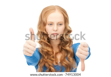 bright picture of lovely teenage girl with thumbs up and thumbs down - stock photo