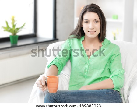 bright picture of lovely woman with mug - stock photo