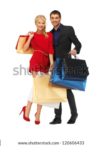 bright picture of man and woman with shopping bags - stock photo