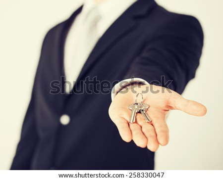 bright picture of man hand holding house keys - stock photo