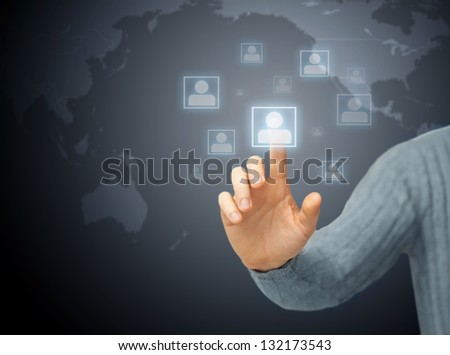bright picture of man pressing imaginary button - stock photo