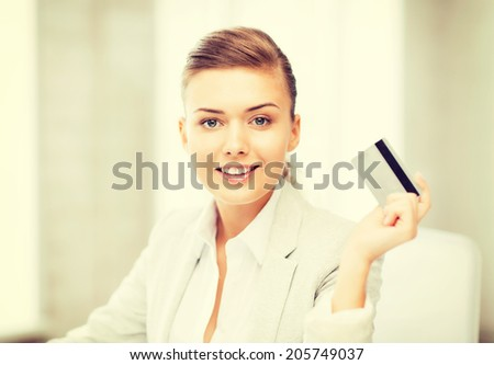 bright picture of smiling businesswoman showing credit card - stock photo