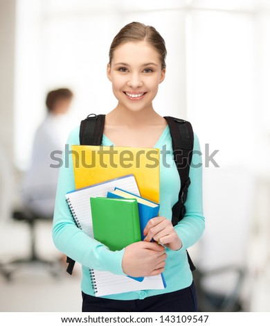bright picture of smiling student with books and schoolbag - stock photo