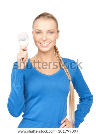 bright picture of woman holding energy saving bulb - stock photo