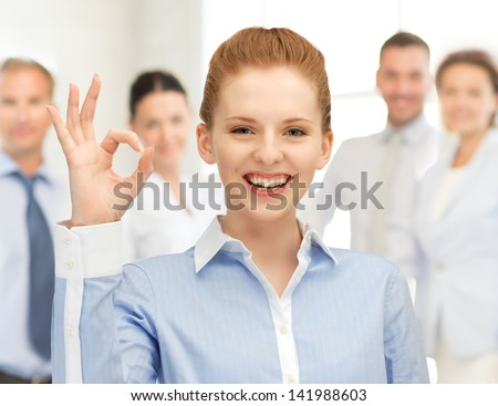 bright picture of young woman showing ok sign - stock photo