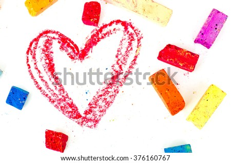 Bright pieces of chalk with the read heart drawn on white. Valentines - stock photo
