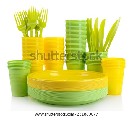 Bright plastic disposable tableware isolated on white - stock photo