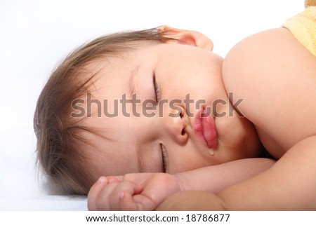 bright portrait of adorable sleeping baby - stock photo