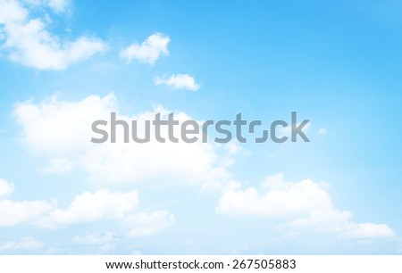 Bright puffy clouds and blue sky in sunny day. Sky and clouds texture background. - stock photo
