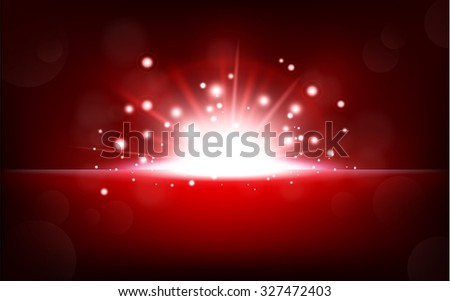 Bright red light rising from the black horizon - stock photo