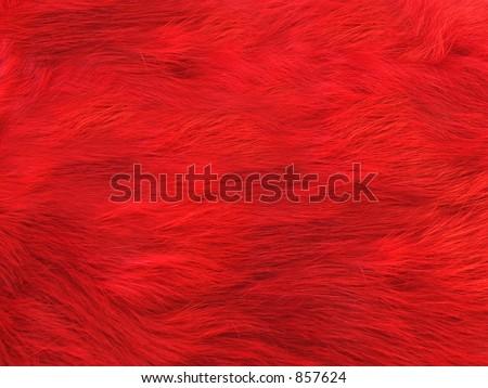 Bright red rabbit fur background. - stock photo
