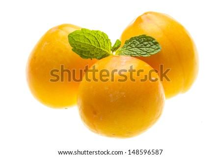 Bright ripe plum with mint - stock photo