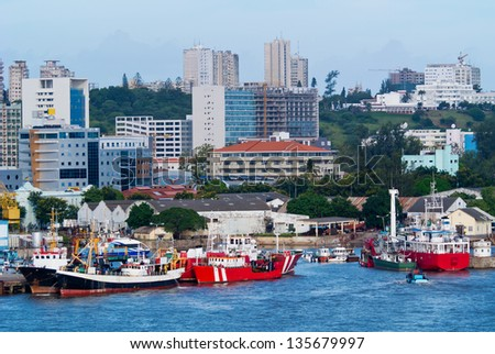 Bright scene from Maputo of ships and buildings - stock photo