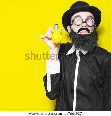 Bright Science School Teacher Standing Against Yellow Classroom Wall With Light Bulb In Hand, Depicting A Creative Idea - stock photo