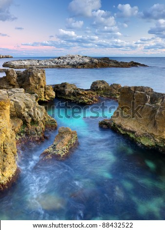 Bright sea bay during sundown. Composition of the nature - stock photo