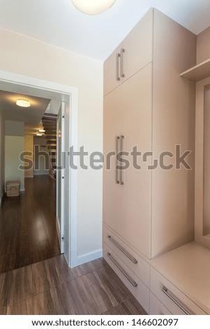 Bright space - a corridor with a wardrobe - stock photo