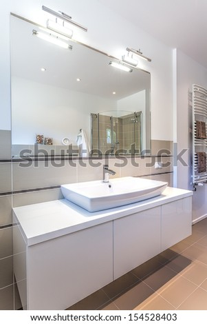 Bright space - a white modern ladies room with a big mirror - stock photo