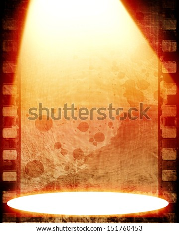 bright spotlight on a film strip with some stains on it - stock photo